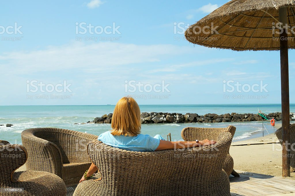 resting on a lounge chair royalty-free stock photo