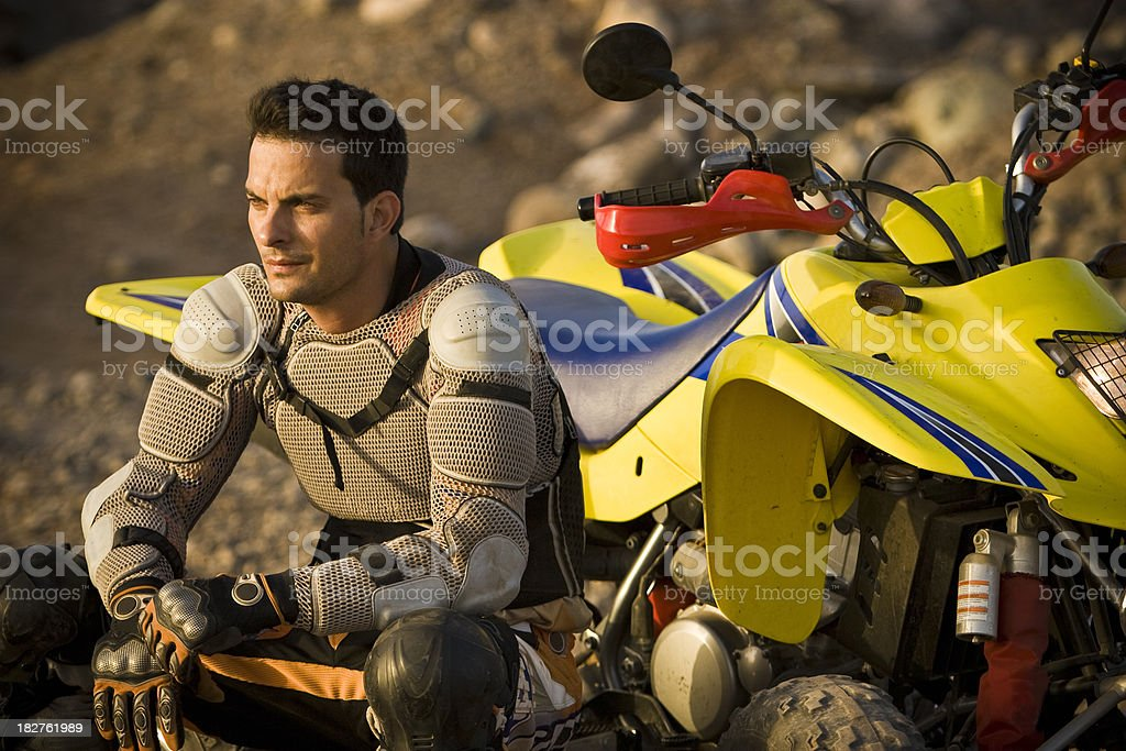 Resting on his ATV royalty-free stock photo