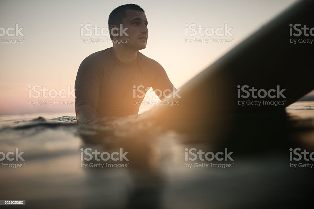 Resting on my surfboard stock photo