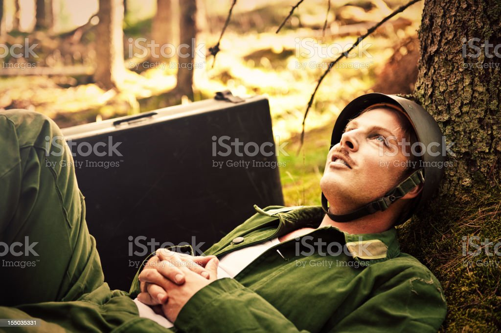 resting soldier in the woods stock photo