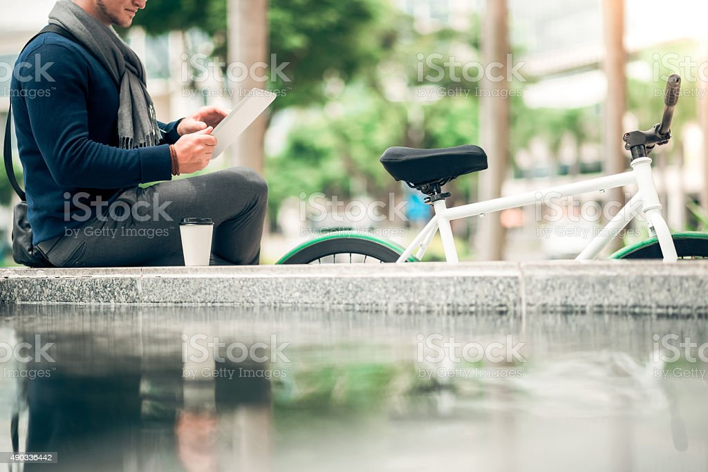 Resting with tablet computer stock photo