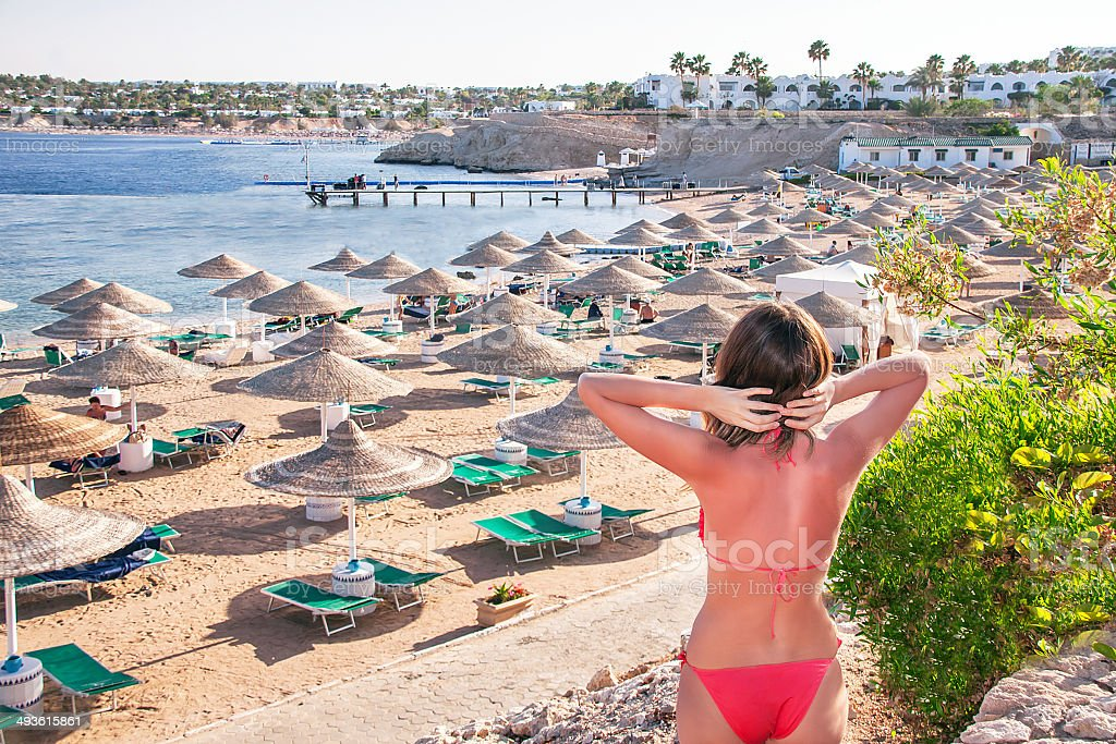 Resting  woman is standing and enjoying in at the beach. stock photo