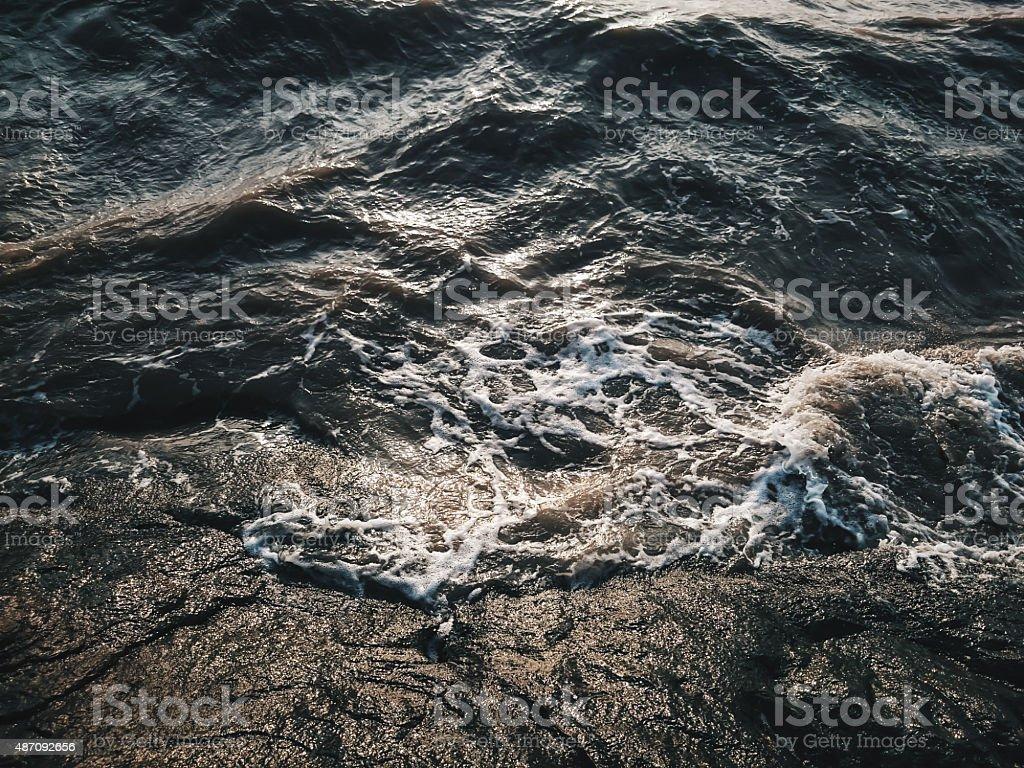 Restless Water Waves Clashing at Rocks stock photo