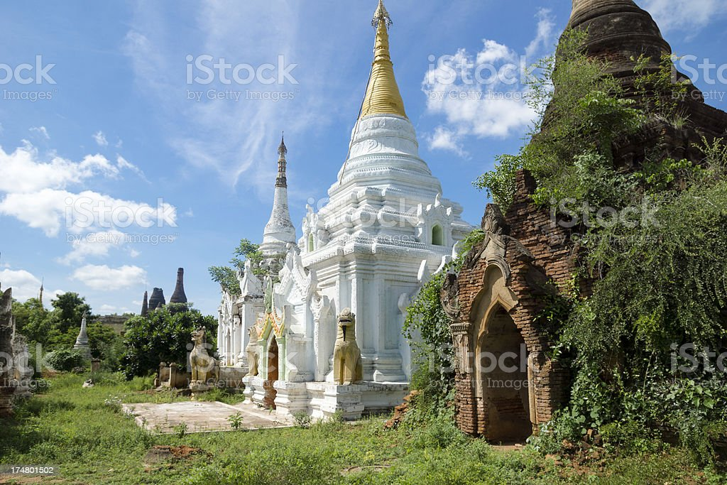 Restored and overgrown / crumbled pagodas at Ma Au, Myanmar royalty-free stock photo