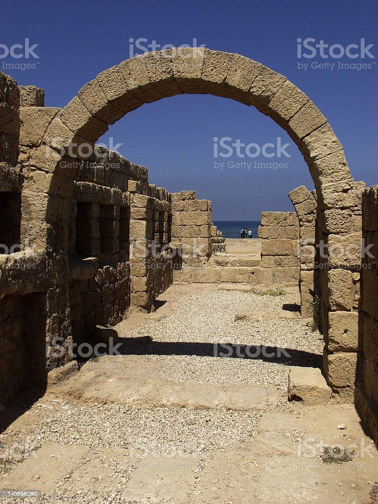 Restored archway in ruins of Caesarea stock photo