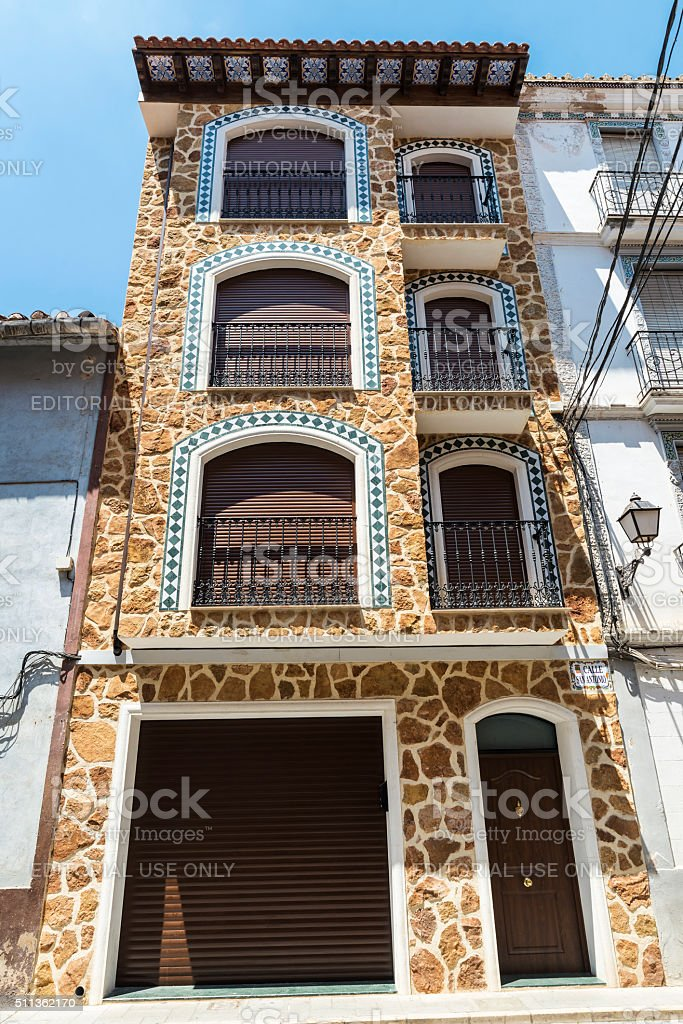 Restored facade of a house in a village, Spain stock photo
