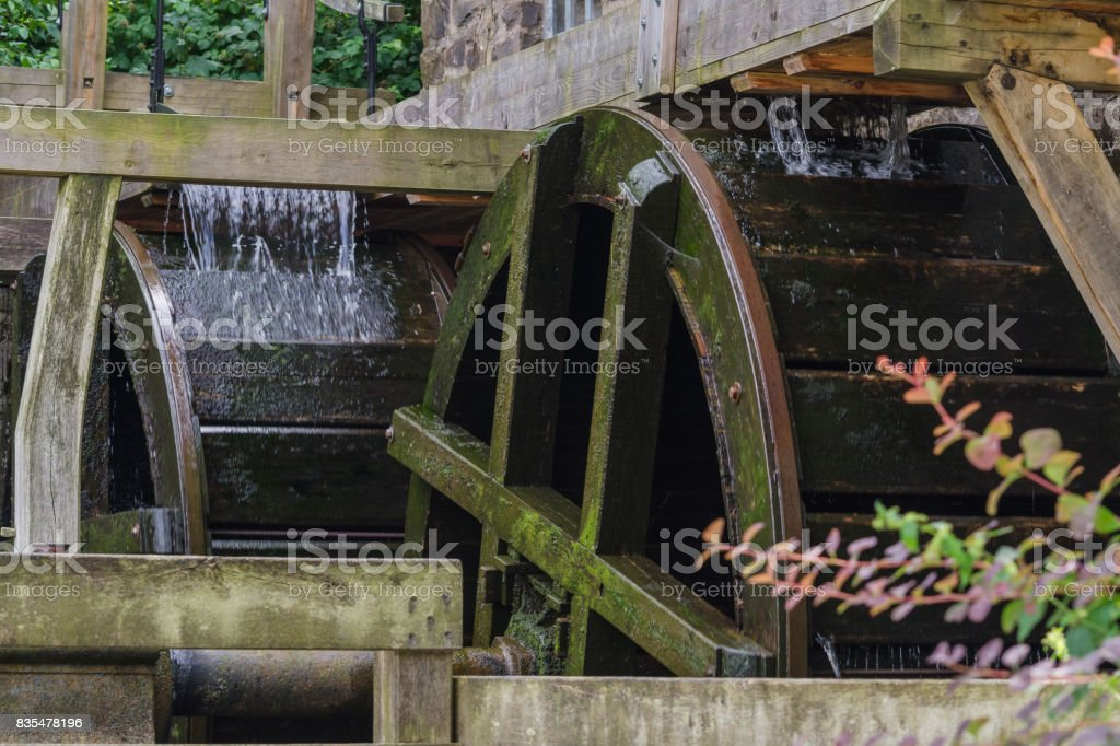 Restored Mill Wheel of an old Water Mill stock photo