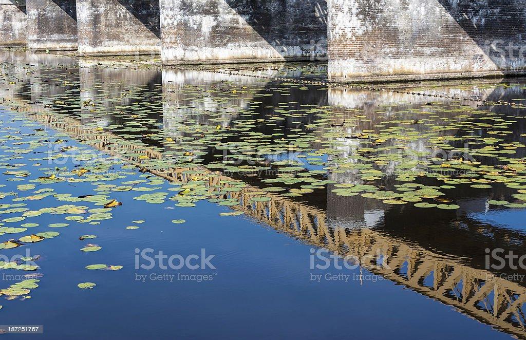 Restored Railway bridge in water reflection stock photo