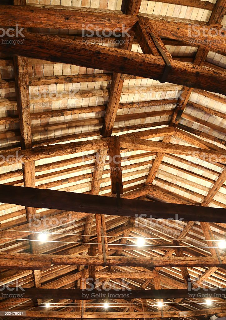 restored roof with wooden beams and the lamps stock photo