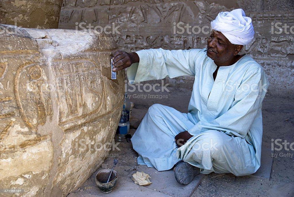 restorer in Karnak temple royalty-free stock photo