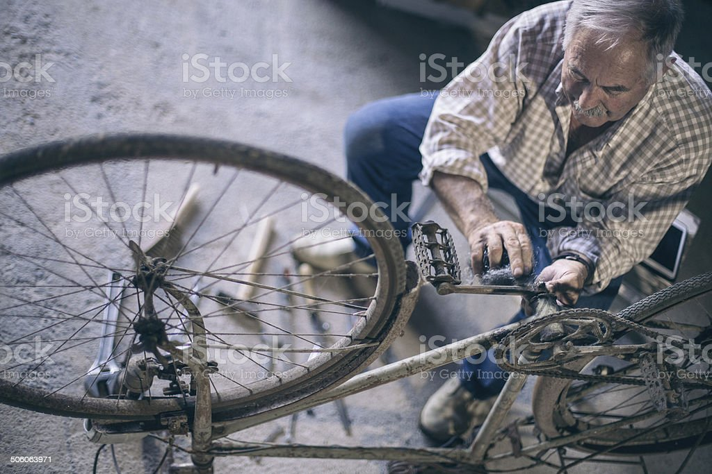 Restoring an old bicycle royalty-free stock photo