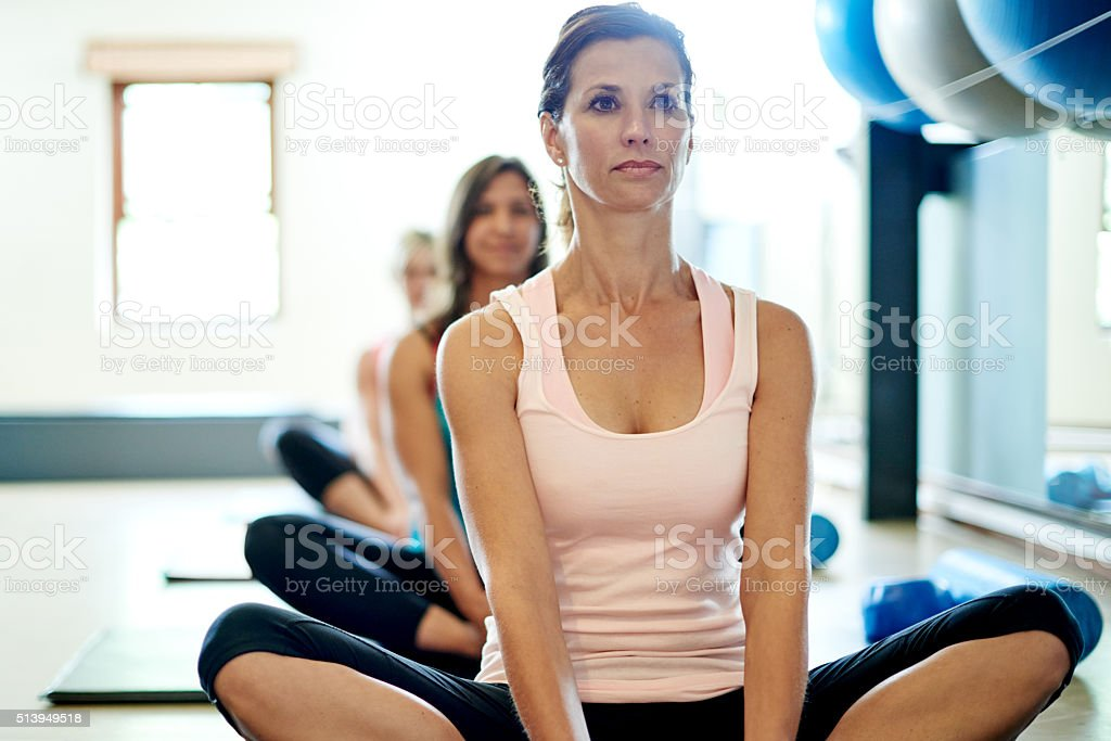 Restoring calm and peace with pilates stock photo