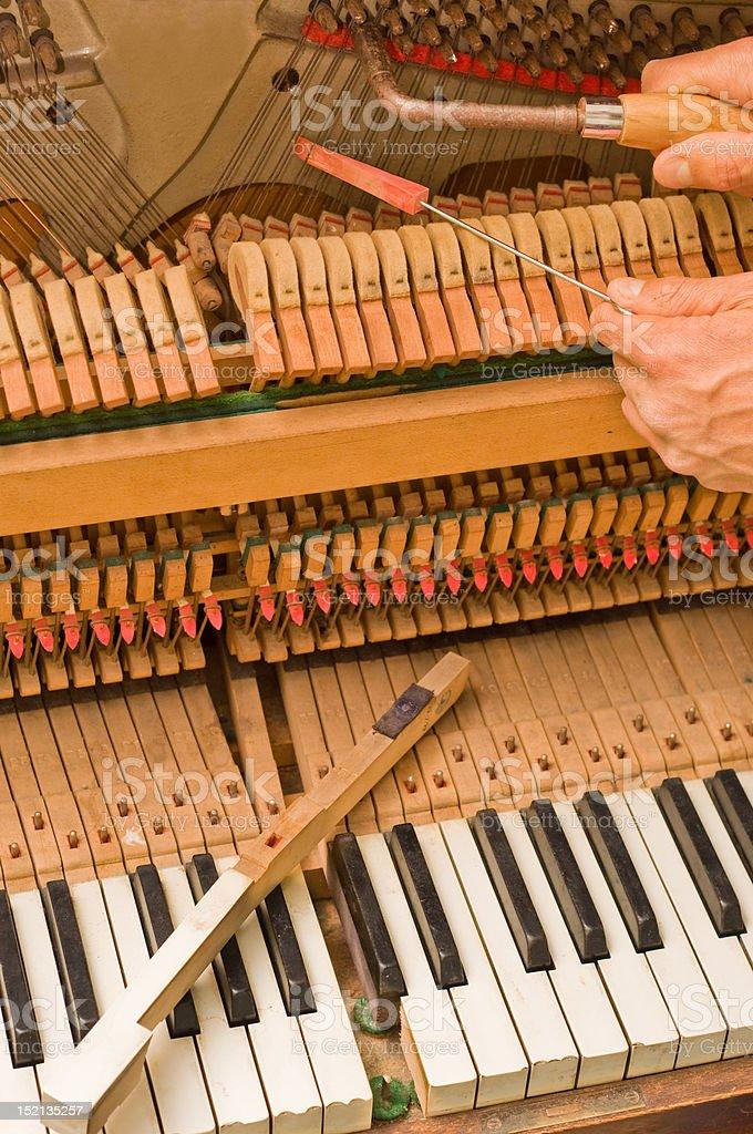 Restoring old piano royalty-free stock photo