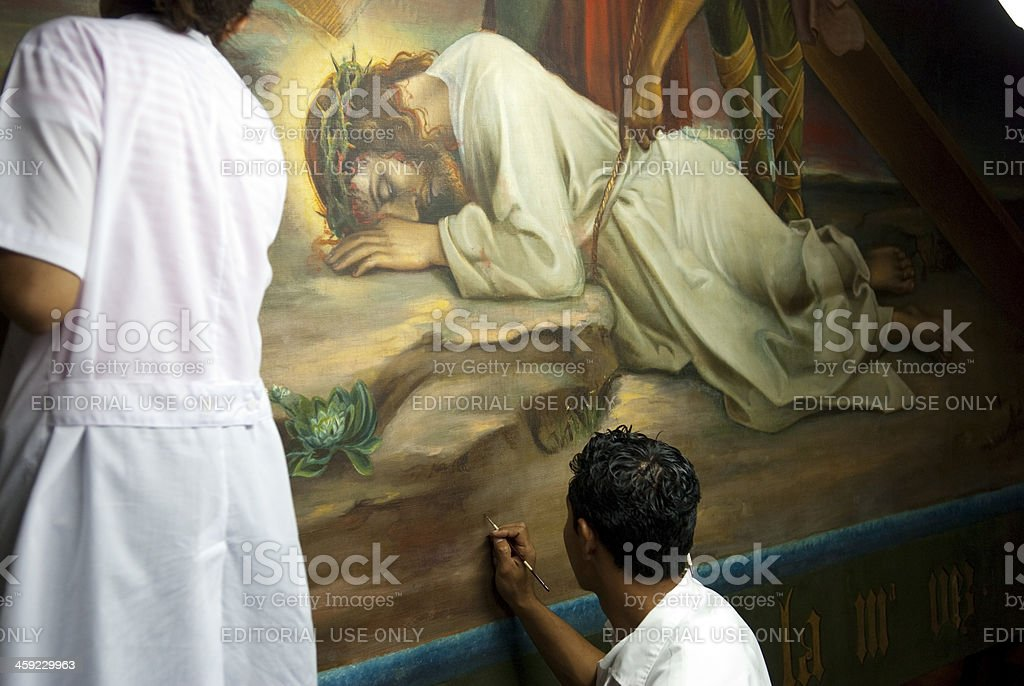 Restoring painting of Jesus at León Cathedral stock photo