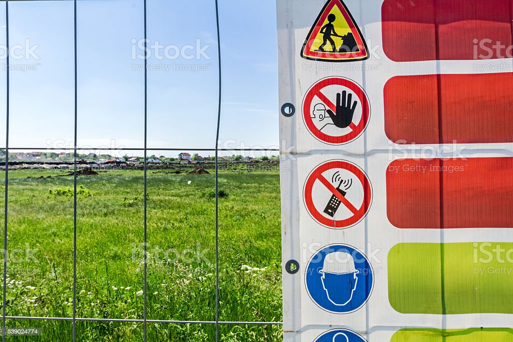 Restricted area, for the authorized personnel only. Construction stock photo
