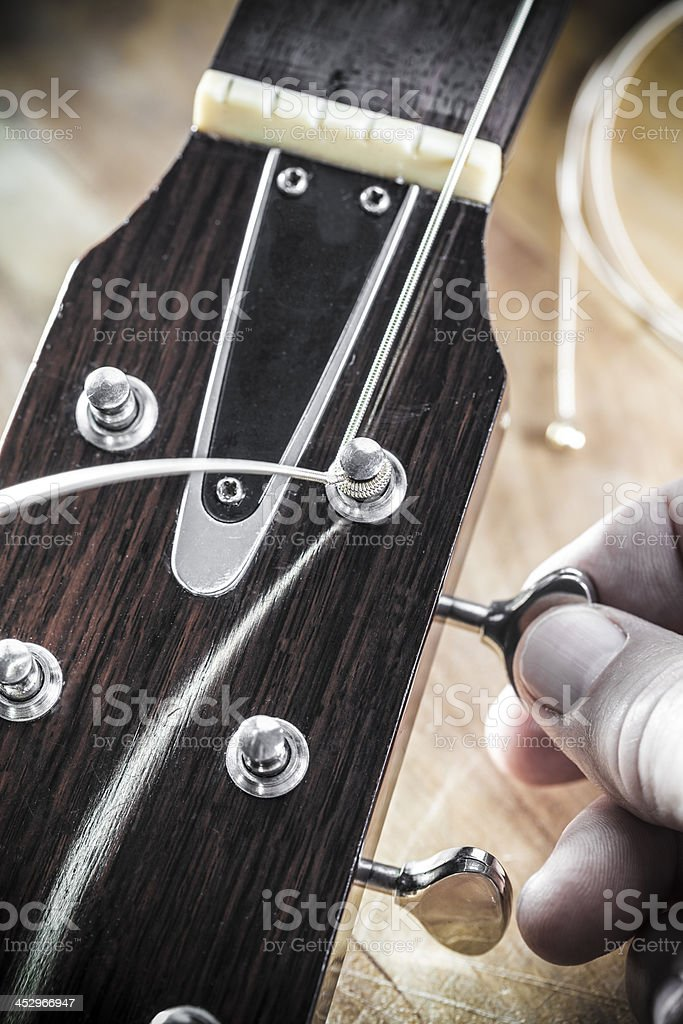 Restringing Guitar royalty-free stock photo