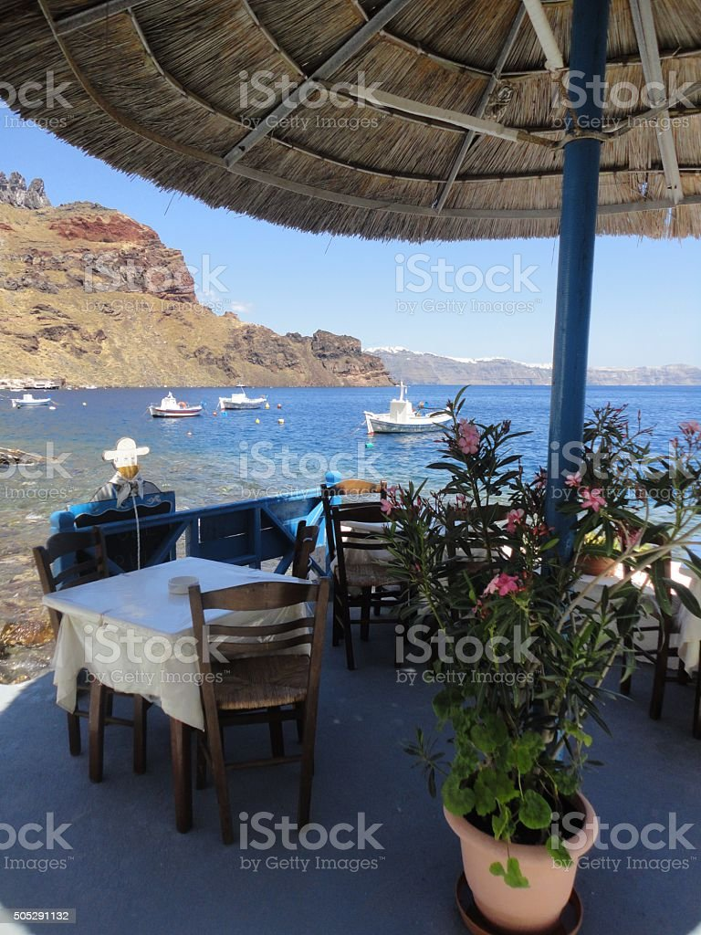 Resturant Table in the Port of Thirasia stock photo