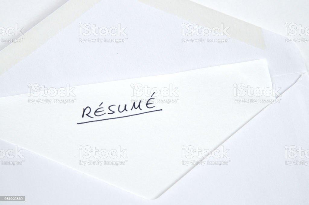 Resume in handwriting in white envelope stock photo