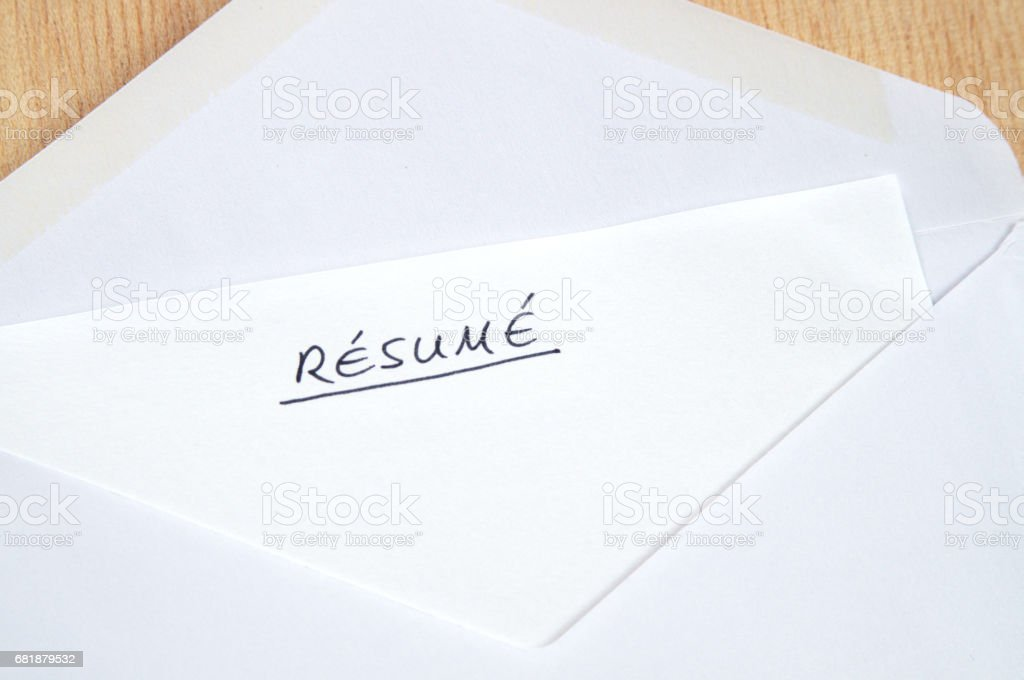Resume in handwriting in white envelope, wooden background stock photo