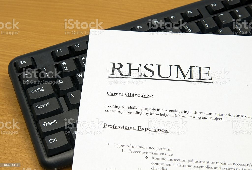 A resume sitting on a black keyboard royalty-free stock photo