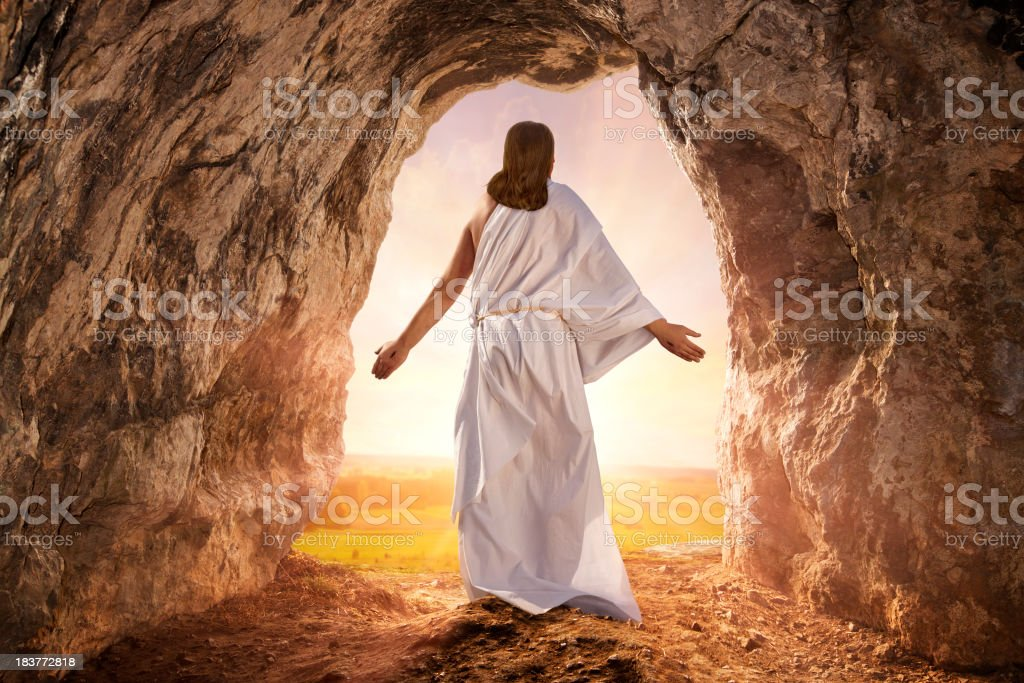 Resurrected Jesus Christ comes from the grave stock photo