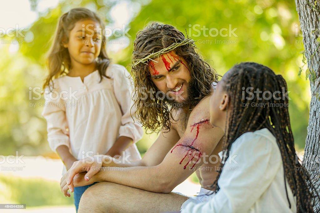 Resurrected Jesus Talking with Children stock photo