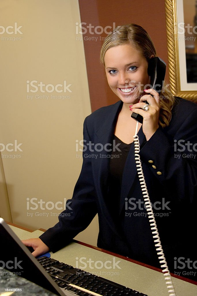 Retail Desk Smile on Phone royalty-free stock photo