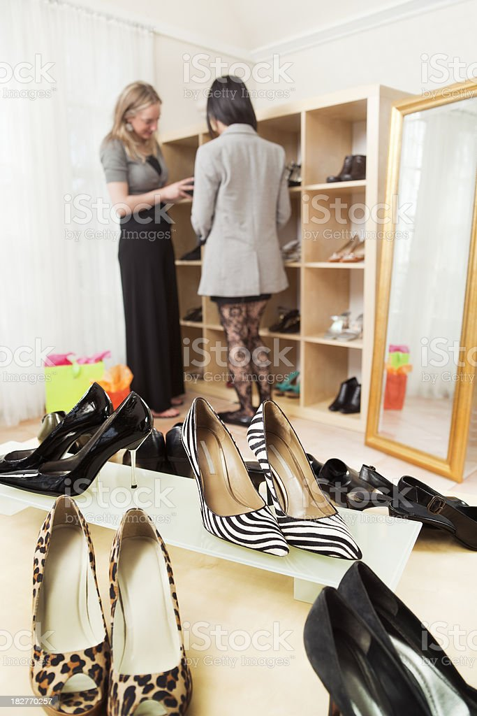Retail Fashion Shoe Store Business with Customer and Sales Clerk royalty-free stock photo
