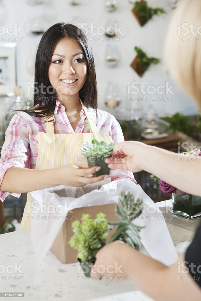Retail Florist Store Owner Serving Customer Vt royalty-free stock photo