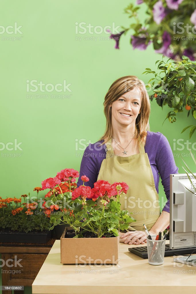 Retail Flower Garden Center Business Owner in Spring Season Vt royalty-free stock photo
