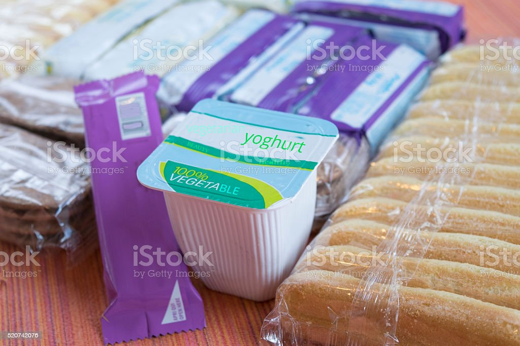 retail packs of snacks pot yoghurt and cookies stock photo