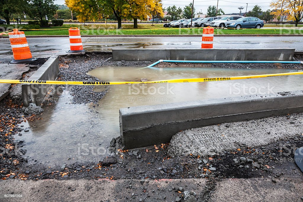 Retail Parking Lot Concrete Curb Road Construction Zone Rain Puddle stock photo