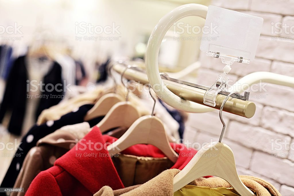 Retail Shopping Sale - Winter coats in Fashion Store royalty-free stock photo