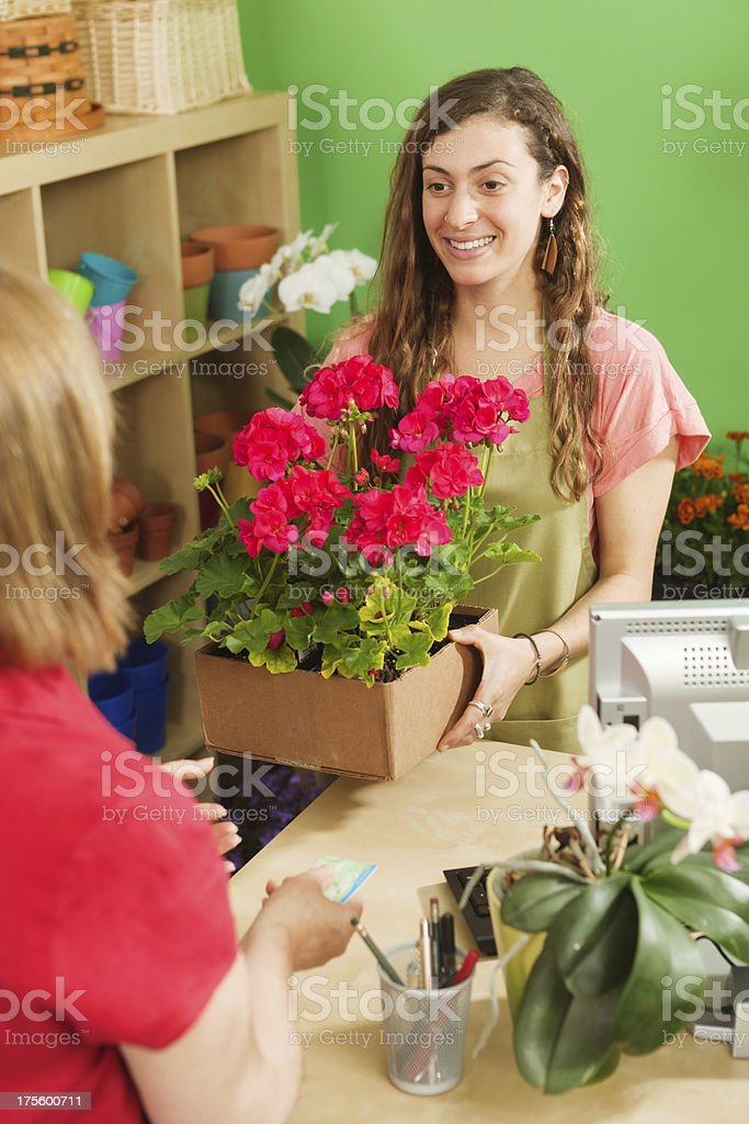 Retail Small Business Flower Shop Cashier Helping Customer royalty-free stock photo