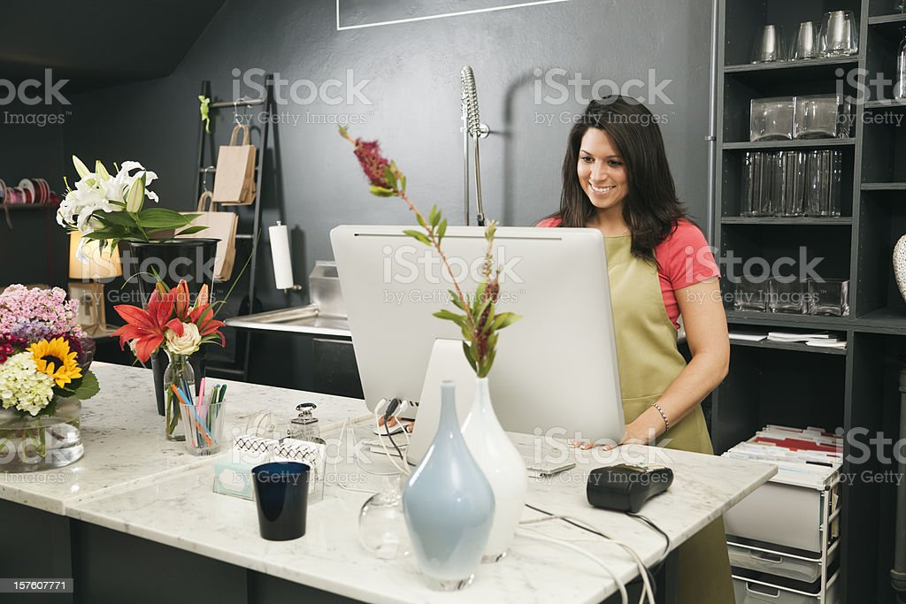 Retail Small Business Store Owner Working in Flower Shop Checkout royalty-free stock photo