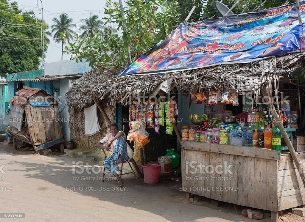 Retailer with ramshackle booth along the street. stock photo