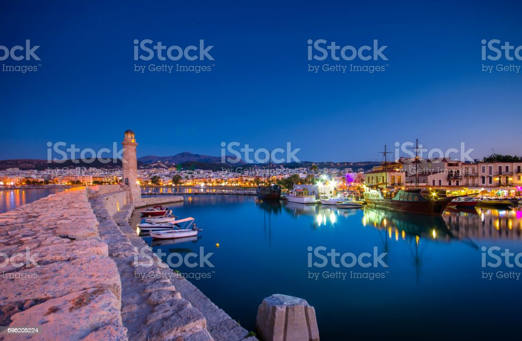 Rethymno city at Crete island in Greece. The old venetian harbor at night. stock photo