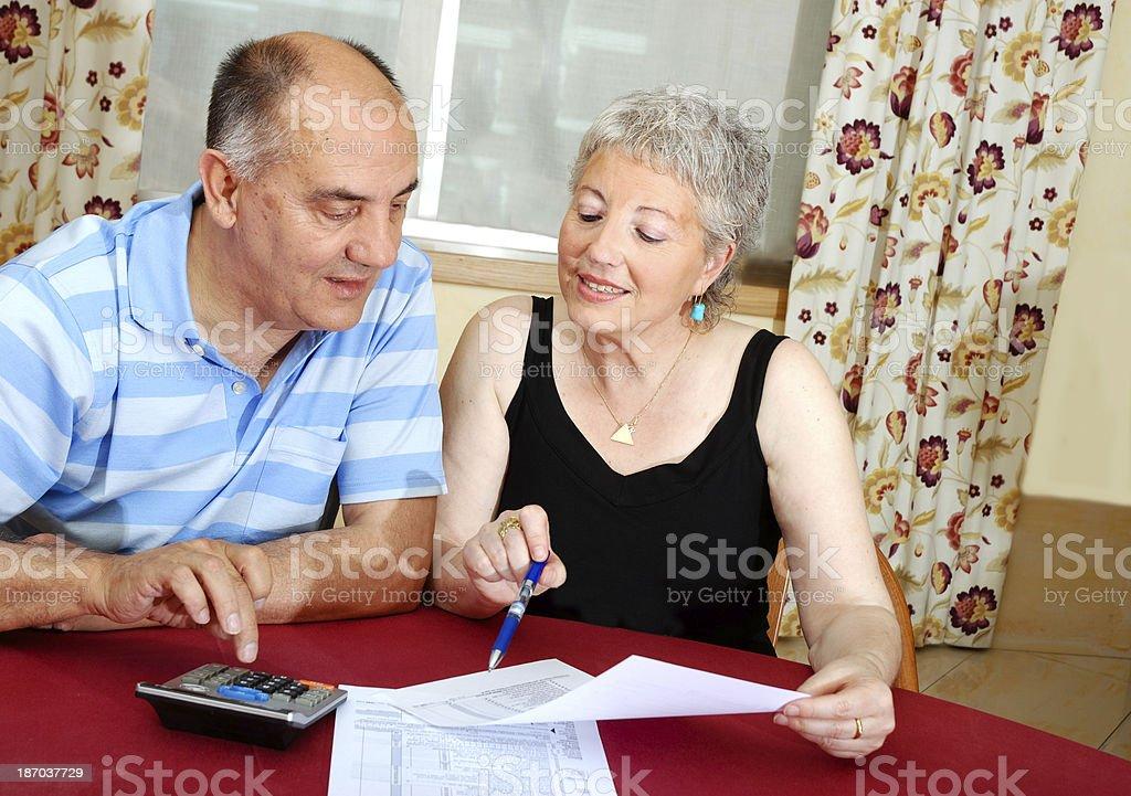 Retire couple doing taxes royalty-free stock photo