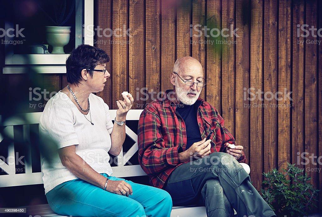 Retired couple enjoying an apple stock photo