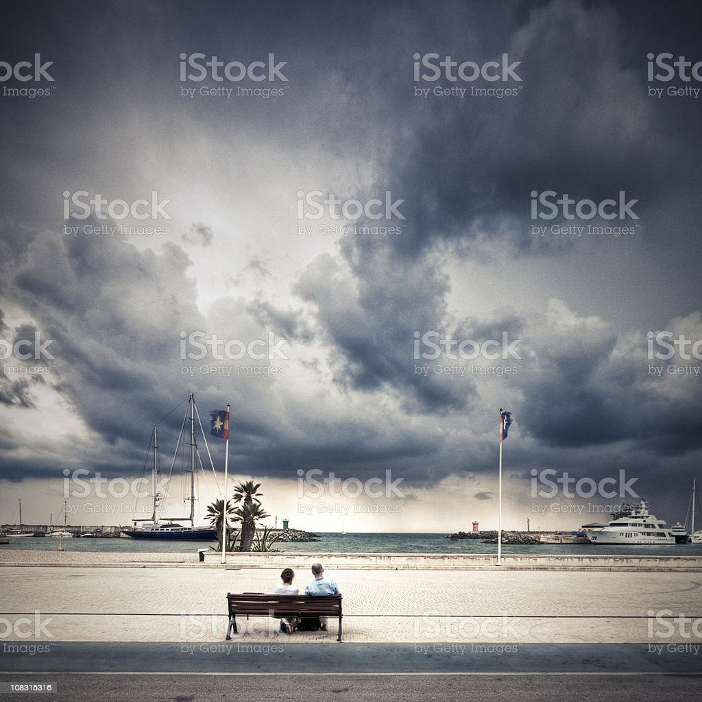 Retired couple facing the storm royalty-free stock photo