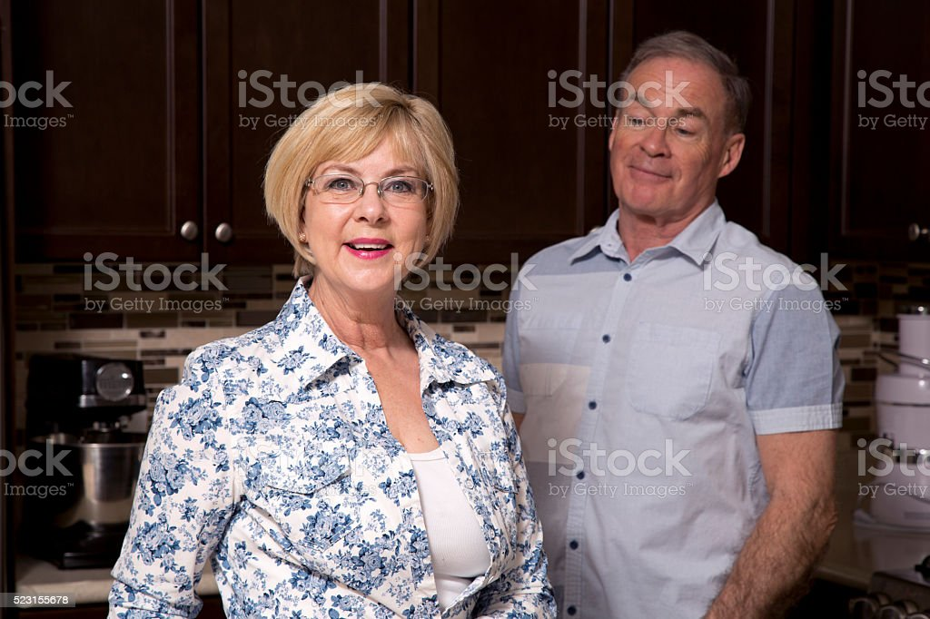 retired couple in the kitchen stock photo