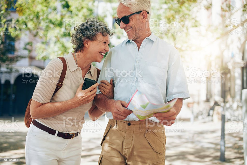 Retired couple walking around the town stock photo