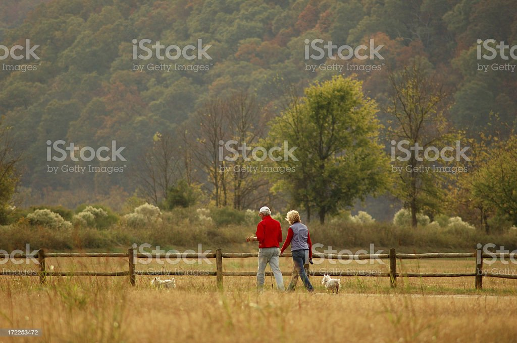 Retired couple walking on a path royalty-free stock photo