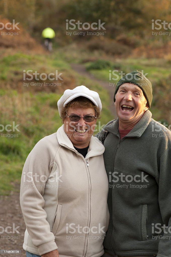 retired couple walking royalty-free stock photo