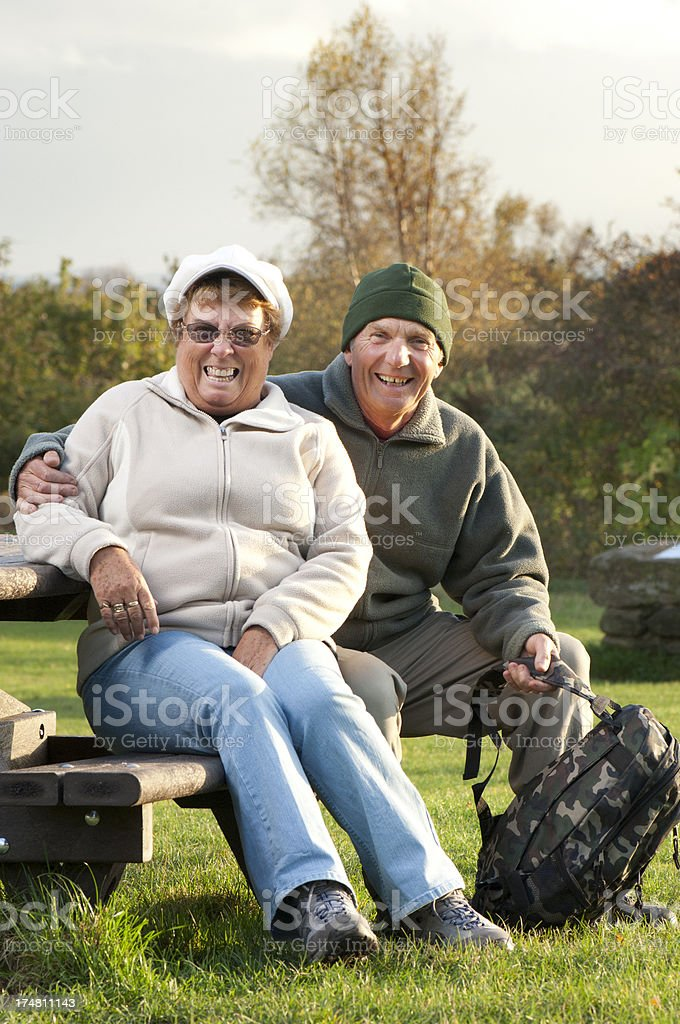 retired couple walking royalty-free stock photo