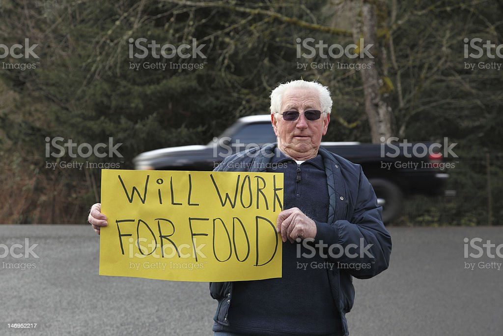 Retired elderly man with sign for work and food royalty-free stock photo