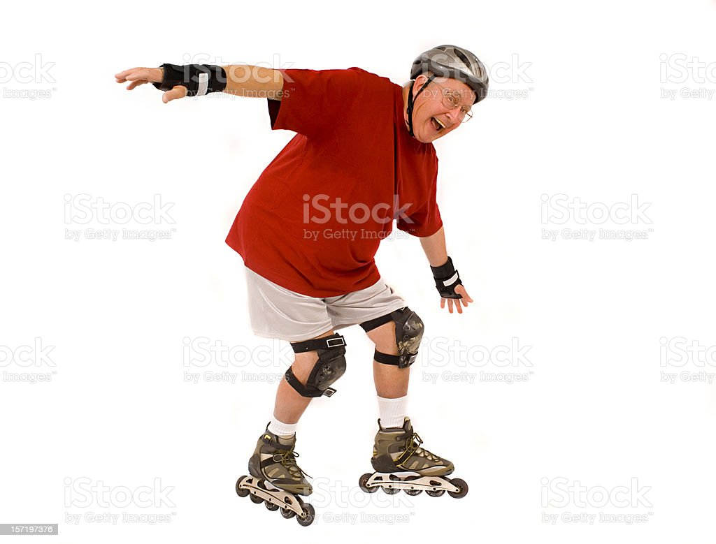retired guy goes inline skating stock photo