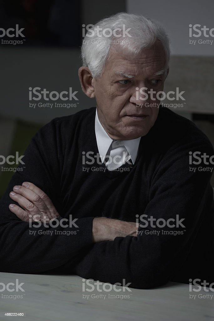 Retired man alone stock photo