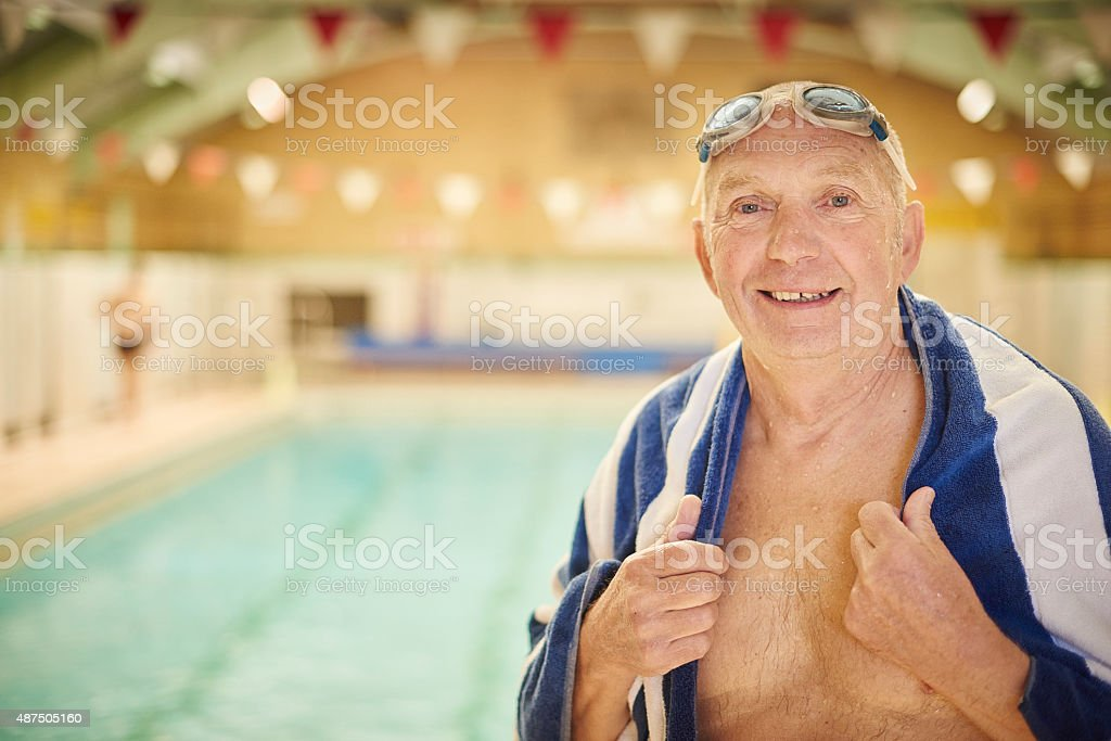 retired man at the swimming pool stock photo