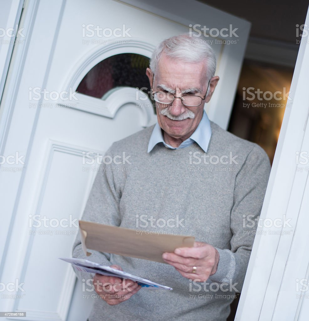 Retired man checking the mail stock photo